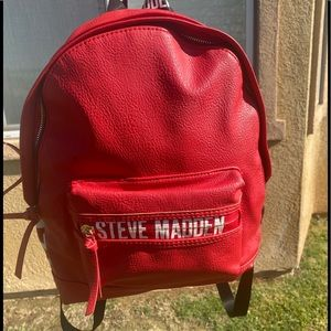 STEVE MADDEN res and white backpack , used